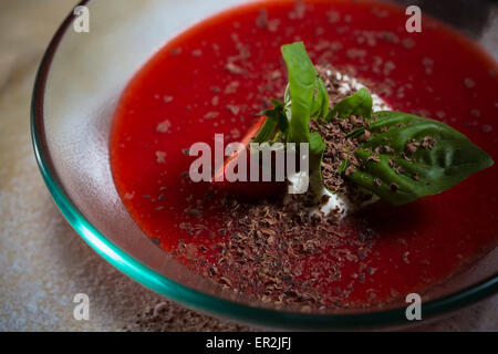 strawberry soup with ice cream and mint on a plate decoratedfresh strawberries - Stock Photo