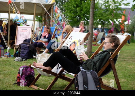Hay Festival, Powys, Wales - May 2015  - Half Term at Hay Festival a teenage reader enjoys the chance to sit, read - Stock Photo