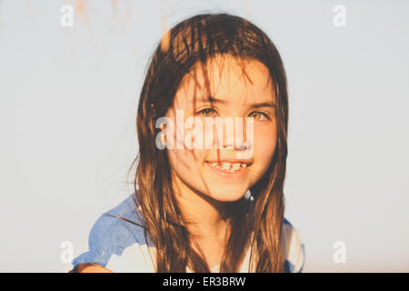 Smiling girl with shadows on her face - Stock Photo