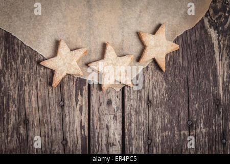 Sweet cookies in star shape on rustic wood. Debica, Poland - Stock Photo