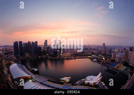 View over Marina Bay to skyline at night, Downtown core, Singapore - Stock Photo