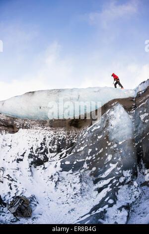 Man walking on a glacier - Stockfoto