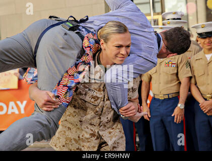 US Marine 1st Lt. Monica Witt carries MSNBC news anchor Thomas Roberts during the morning talk show Today as a part - Stock Photo