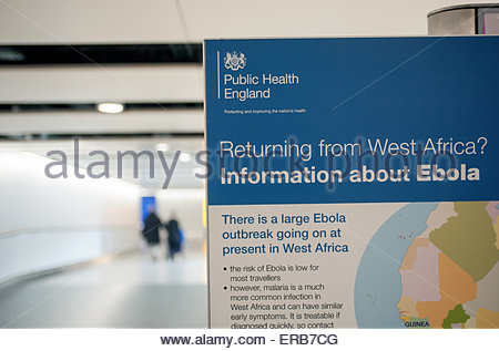 London Heathrow Airport UK. Ebola information board for arriving passengers. - Stock Photo