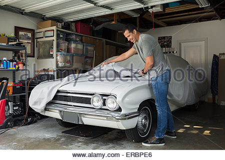 Man in classic american car street scene trinidad central for American classics garage