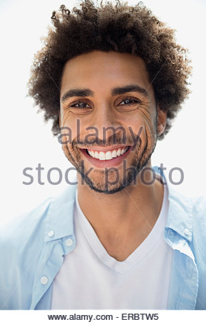Close up portrait smiling man curly hair stubble - Stock Photo