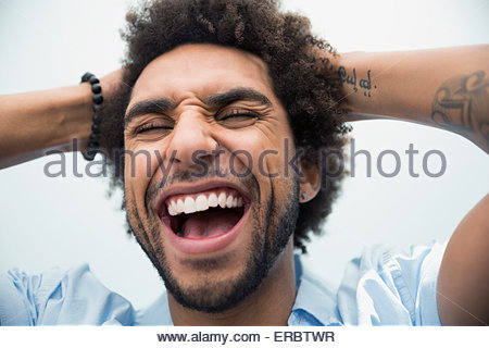 Close up portrait enthusiastic man with eyes closed - Stock Photo