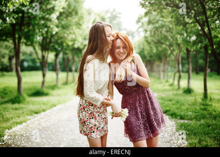 Two Young Happy Girls Having Fun in the Summer Park. Best Friends Laughing and Embracing. - Stockfoto
