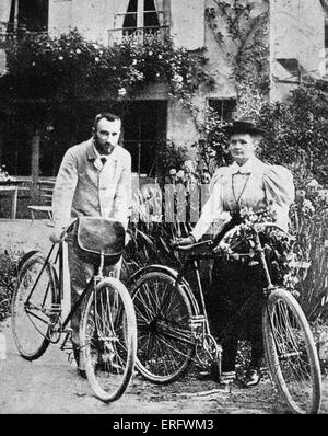 Pierre and Marie Curie with the bicycles on which, during their early married life, the roamed the roads of France - Stock Photo