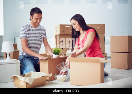 Woman unpacking a box stock photo royalty free image 7867610 alamy - Young couple modern homes ...