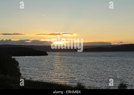 Kielder Water at sunset. Kielder Water, operated by Northumbrian Water, is the largest artificial lake in the UK - Stock Photo