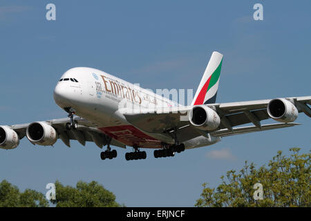 Emirates Airbus A380 long haul airliner on approach to London Heathrow Airport. Front view closeup. - Stock Photo