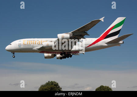 Emirates Airbus A380 long haul airliner on approach to London Heathrow - Stock Photo