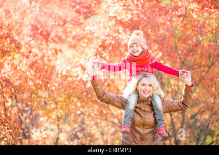 Happy family walking in fall - Stock Photo