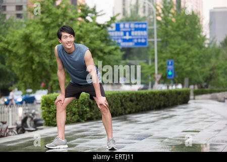 Young man taking a break from exercise - Stock Photo