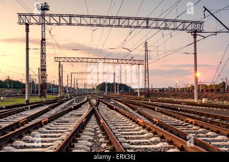 Cargo train platform at sunset. Railroad in Donetsk. Railway station - Stock Photo