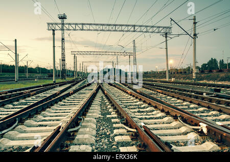 Cargo train platform at sunset. Railroad in Donetsk. Railway station - Stock Photo