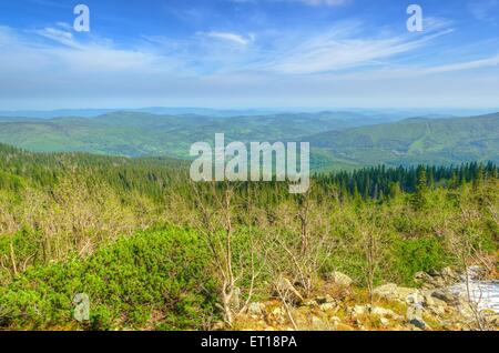 HIghland landscape in spring. Picturesque view stretches of the highest peak in Beskids mountains (Babia Gora), - Stock Photo