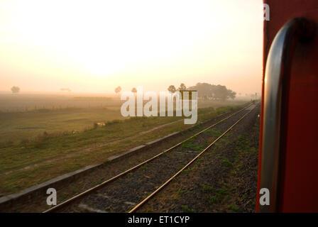 Sunset at imali railway station ; West Bengal ; India - Stock Photo