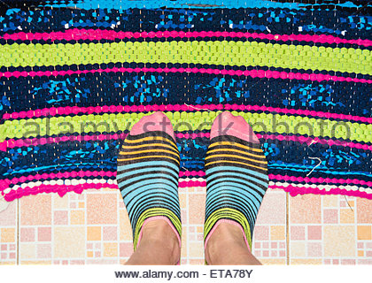 Bright patterned socks on feet - Stock Photo
