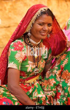 Portrait of a Rajasthani woman in distinctive Rajasthani dress and jewellery, Jaisalmer, India - Stock Photo