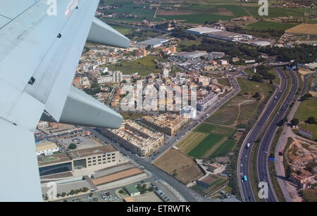 Airplane wing and aerial view with road network east of Palma as the plane departs on April 24, 2015 in Palma de - Stock Photo