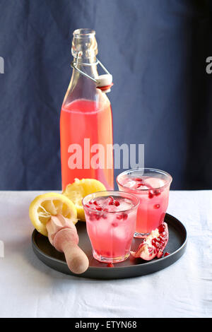 Two glasses and a bottle with pomegranate lemonade - Stock Photo