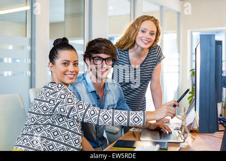 Professional designers working on computer - Stock Photo