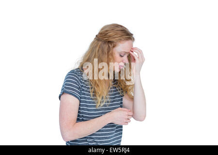 Woman with headache pinching her nose - Stockfoto