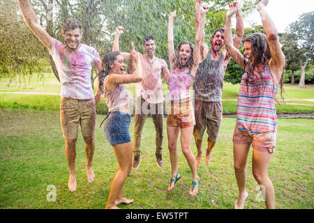 Happy friends jumping in the water shoot - Stock Photo