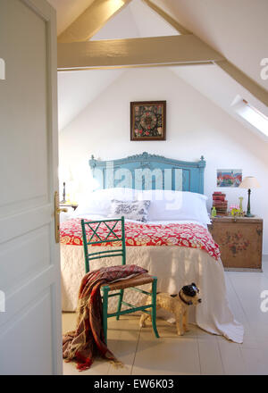 Toy dog beside painted chair in french country bedroom for Dog bed beside bed