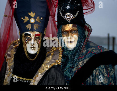 Revellers wearing traditional masks and robes at the Carnival in Venice     FOR EDITORIAL USE ONLY - Stock Photo