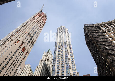 Skyscrapers with crane and Woolworth Building, in New york seen from below, NYC, Manhattan, United states. - Stock Photo