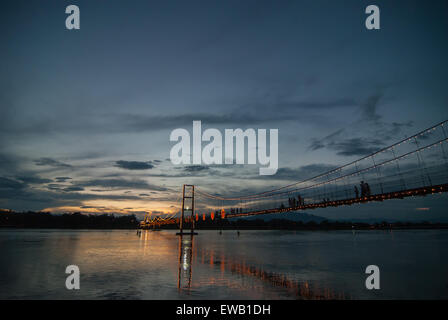 The old wooden bridge Bridge collapse bridge (Rattanakosin suspension bridge) across the Ping river and Wood bridge - Stock Photo