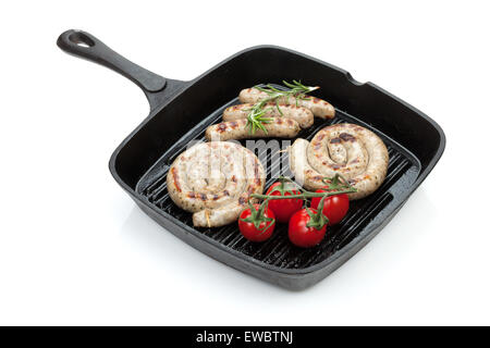 Grilled sausages on frying pan. Isolated on white background - Stock Photo