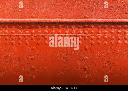 Old ships hull texture, red metal wall with seams and rivets - Stock Photo