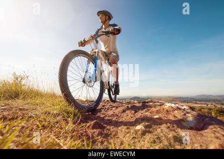 Mountain biker in action - Stock Photo