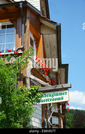 Guest Rooms Sign on wooden board on a guest house in the Black Forest - Stock Photo