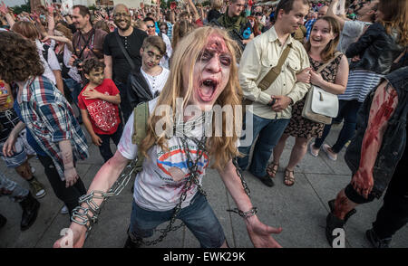 Warsaw, Poland. 28th June 2015. Participants of the 9th Zombie Walk in Warsaw. During annual event people dressed - Stock Photo