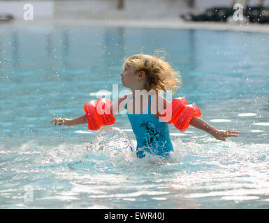 little girl playing in the swimming pool - Stock Photo