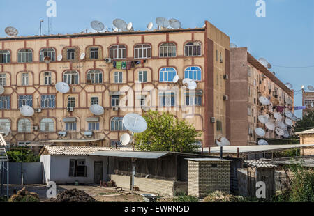 Satellite dishes sprout like mushrooms from Soviet-era apartment blocks in Mary, Turkmenistan - Stock Photo