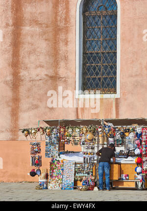 Stall holder putting souvenirs on display, Burano Venetian Lagoon Veneto Italy Europe - Stock Photo