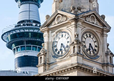 The Town Hall Clock Tower on Queen Street and modern Sky Tower, Auckland,New Zealand - Stock Photo