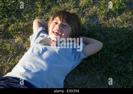 Child With Hands Behind Back One Holding Toy Car Close