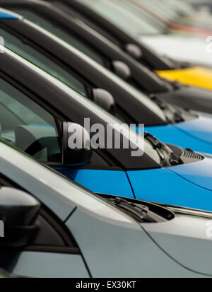 Close Up Of Side Of Cars On Street Parking Next To The