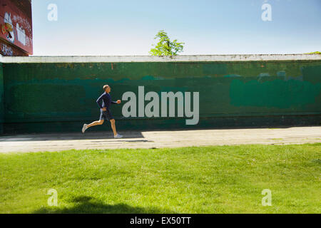 Mature Man Running in the Park - Stock Photo