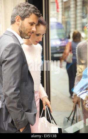 Couple Window Shopping - Stock Photo