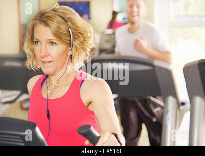 Woman at Gym Using Treadmill - Stockfoto