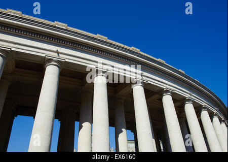 Part of colonnade in St Peter square in Rome, Italy, Vatican City, with blue sunny sky view from the ground - Stock Photo