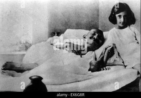 Indira Priyadarshini Gandhi (1917 – 1984) third Prime Minister of India as a girl next to Mahatma Gandhi the Indian - Stock Photo